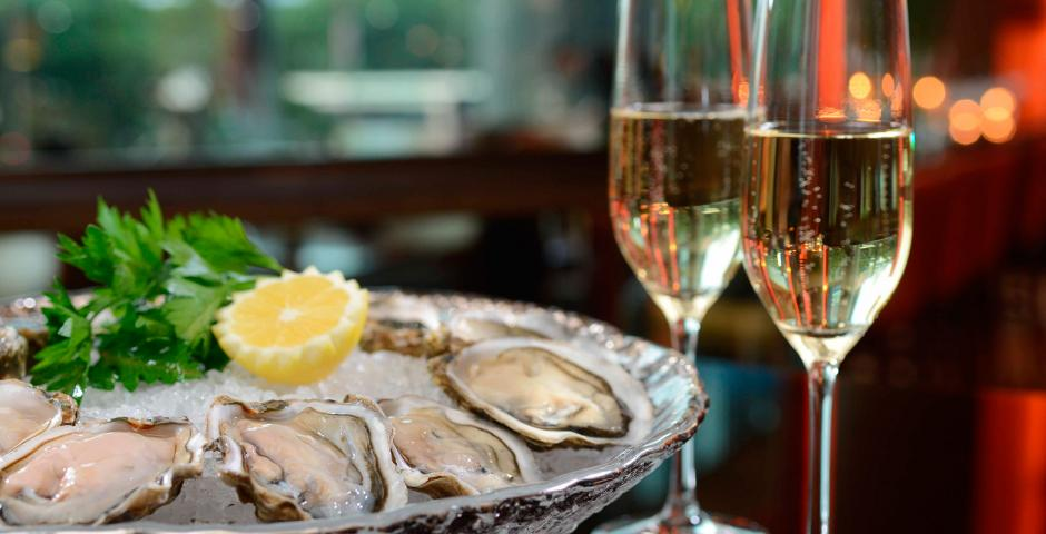 Enjoy the sunset with Champagne & Oysters at Oasis bar